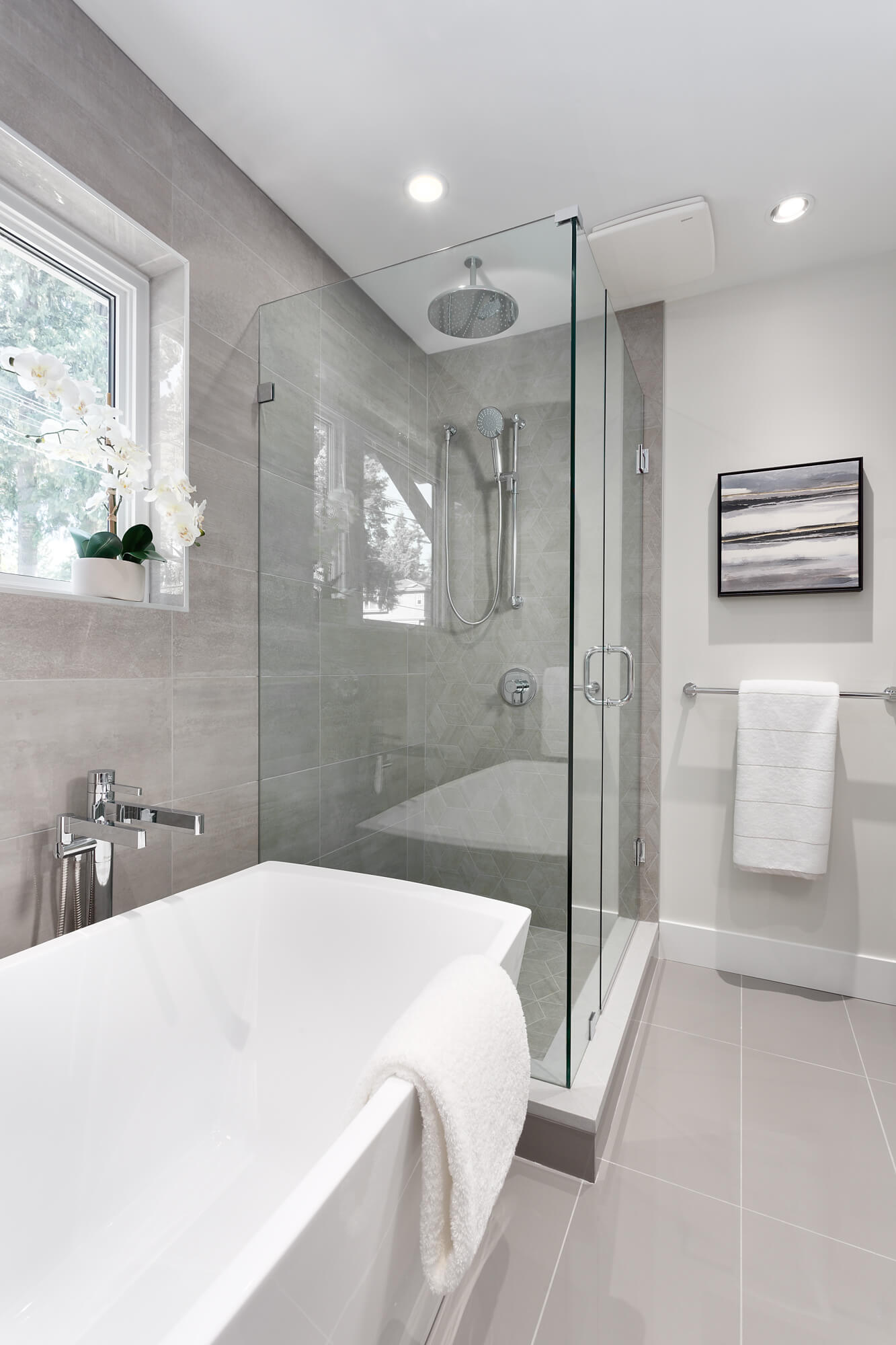 Walk-in Shower with Glass Walls and Stand Alone Tub